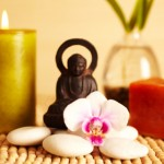 Spa still life buddha statue and candles, orchid flower
